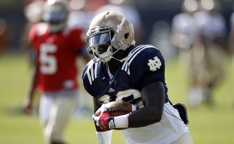 Fighting Irish running back Wood runs a play during a practice session in Davie, Florida