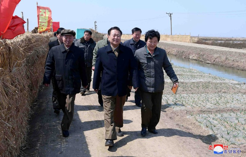 FILE PHOTO - KCNA picture of Choe Ryong Hae, vice-chairman of the central committee of the Workers' Party of Korea (WPK), inspecting a farm in Sariwon