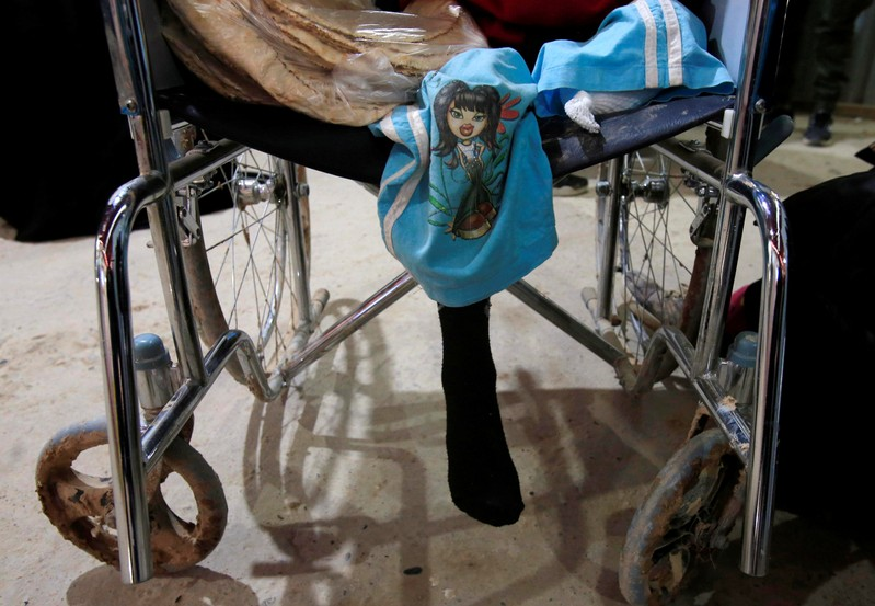 The daughter of an Islamic State fighter sits in a wheelchair at a clinic in al-Hol displacement camp in Hasaka governorate