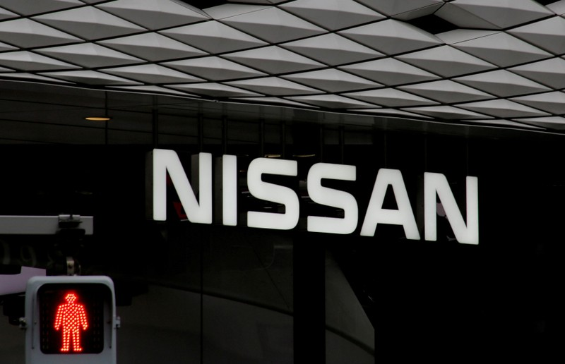 FILE PHOTO : The logo of Nissan Motor Co. is seen at its show room behind a traffic sign in Tokyo