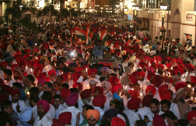 People partricipate in a candle light vigil to pay homage outside Jallianwala Bagh memorial to mark 100th anniversary of Jallianwala Bagh massacre in Amritsar