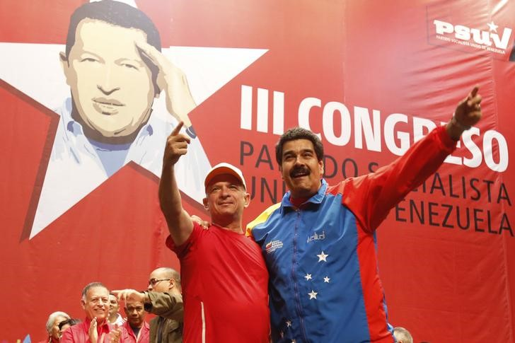 FILE PHOTO: Venezuela's President Maduro embraces retired General Carvajal as they attend the Socialist party congress in Caracas