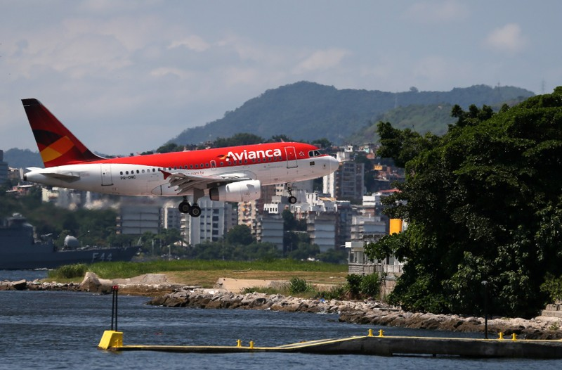 FILE PHOTO: An Airbus A318 of Avianca Brazil prepares to land at Santos Dumont airport in Rio de Janeiro