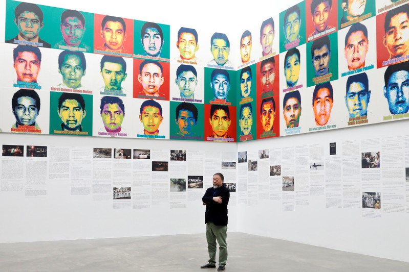 Chinese artist Ai Weiwei poses for photographers during a photocall for his exhibition