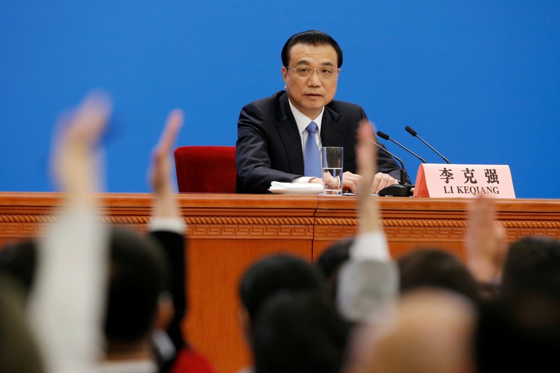 Chinese Premier Li Keqiang attends a news conference following the closing session of the National People's Congress (NPC) at the Great Hall of the People in Beijing