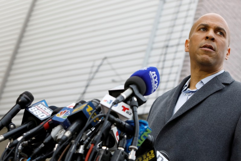 FILE PHOTO: U.S. Senator Corey Booker (D-NJ) speaks to the media outside his home after announcing he will run for president in Newark, New Jersey