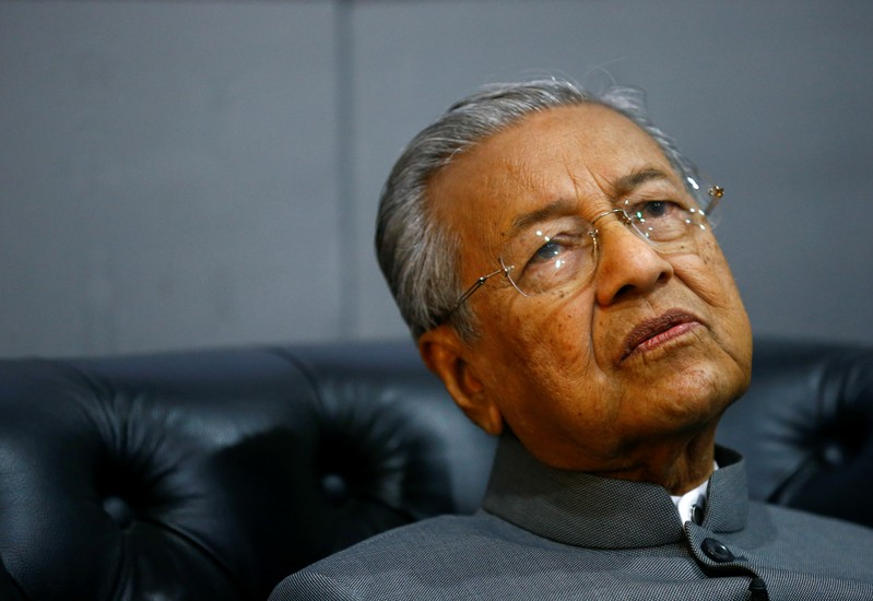 FILE PHOTO: Malaysia's Prime Minister Mahathir Mohamad reacts during an interview with Reuters in Langkawi
