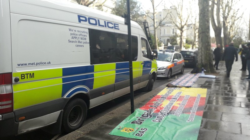 Emergency responders are seen on Holland Park Road in London