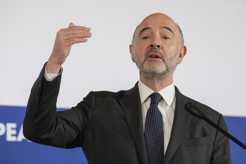 FILE PHOTO: European Economic and Financial Affairs Commissioner Pierre Moscovici speaks during a news conference in Bucharest