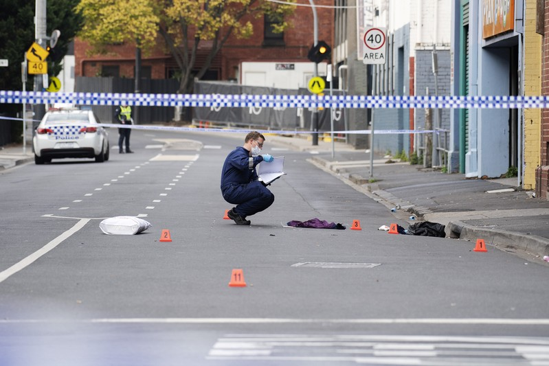 A Victoria Police personnel works at the scene of a multiple shooting outside Love Machine nightclub in Prahran, Melbourne