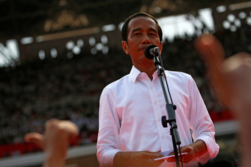 Indonesia's incumbent presidential candidate Joko Widodo reacts as he speaks during a campaign rally at Gelora Bung Karno stadium in Jakarta