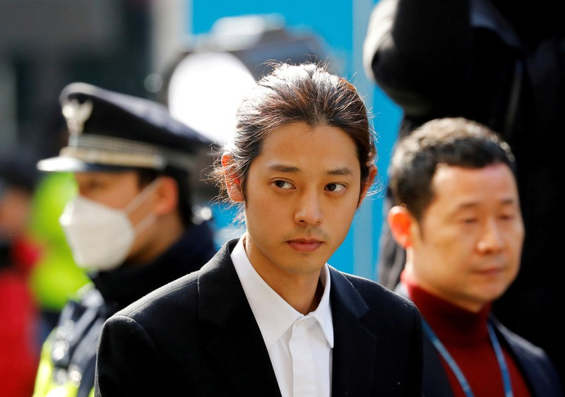 FILE PHOTO: South Korean singer Jung Joon-young arrives for questioning on accusations of illicitly taping and sharing sex videos on social media, at the Seoul Metropolitan Police Agency in Seoul