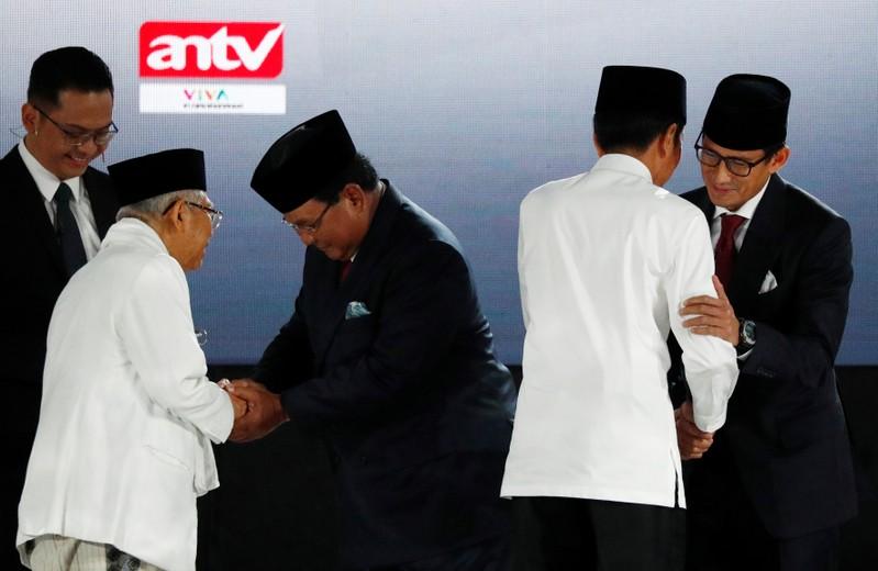Indonesia's President Joko Widodo, his running mate Ma'ruf Amin greet presidential candidate Prabowo Subianto and his running mate Sandiago Uno before a debate in Jakarta, Indonesia