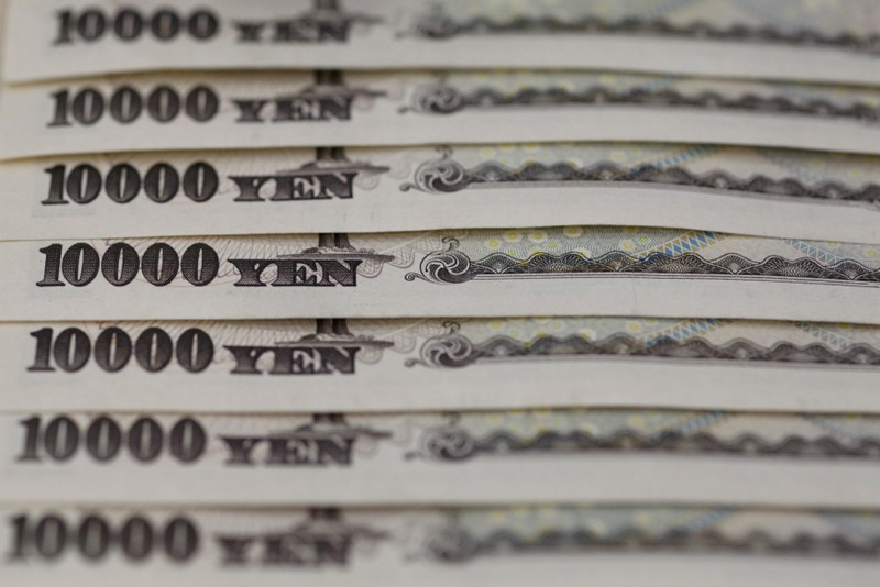 Japanese 10,000 yen notes line up in Tokyo, in this picture illustration