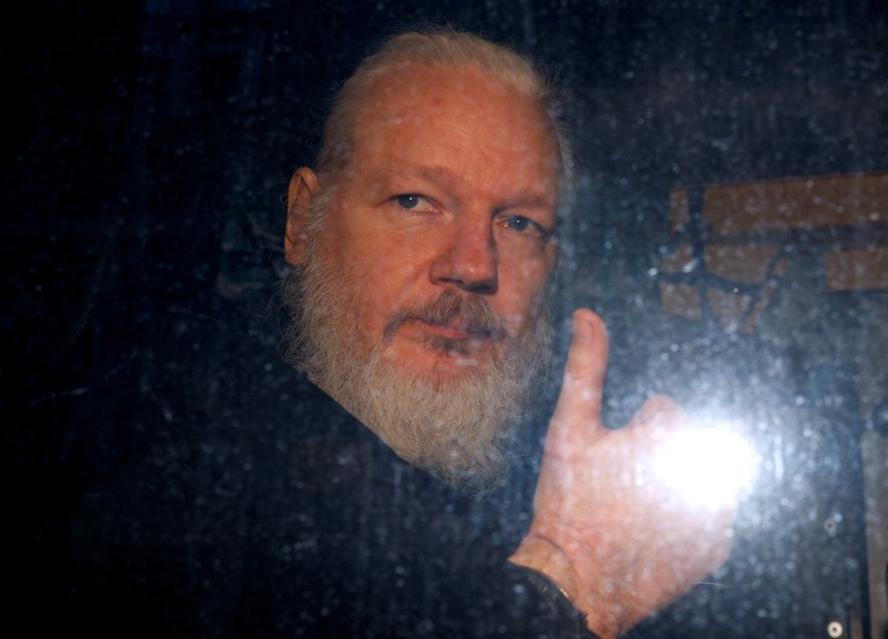 FILE PHOTO: WikiLeaks founder Julian Assange is seen as he leaves a police station in London