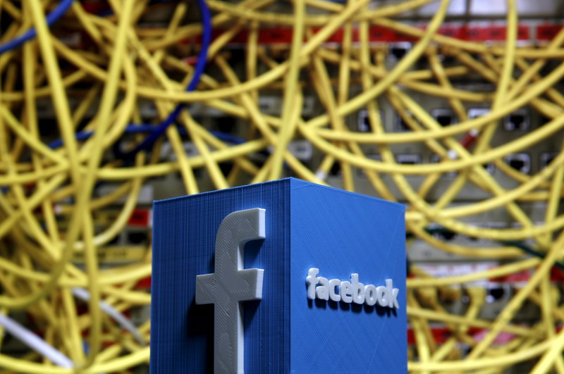 FILE PHOTO: A 3D plastic representation of the Facebook logo is seen in front of displayed cables in this illustration in Zenica