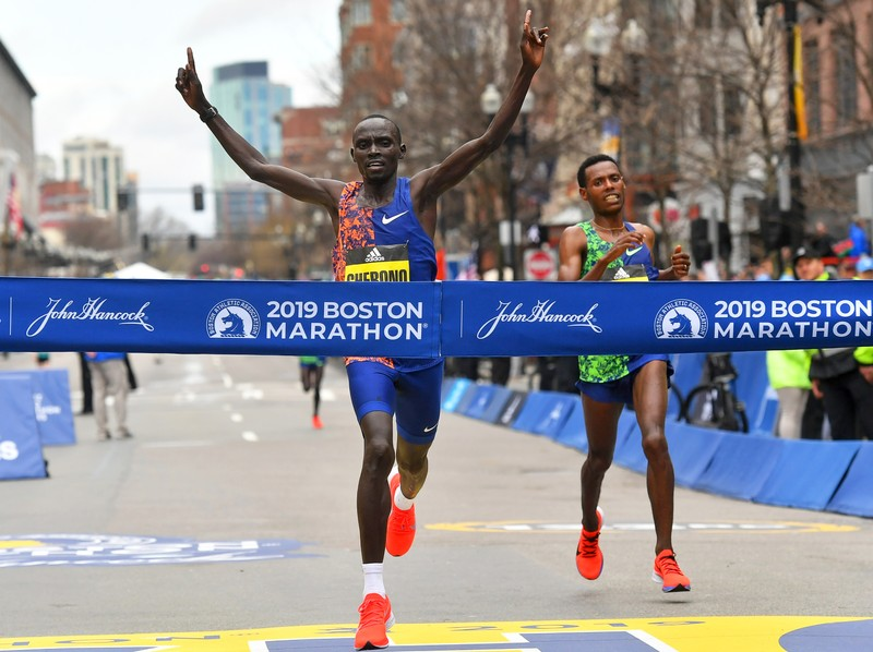Men's winner Lawrence Cherono of Kenya crosses the finish line ahead of Lelisa Desisa of Ethiopia during the 123rd running of the Boston Marathon on the sixth anniversary of the 2013 Boston marathon bombings in Boston
