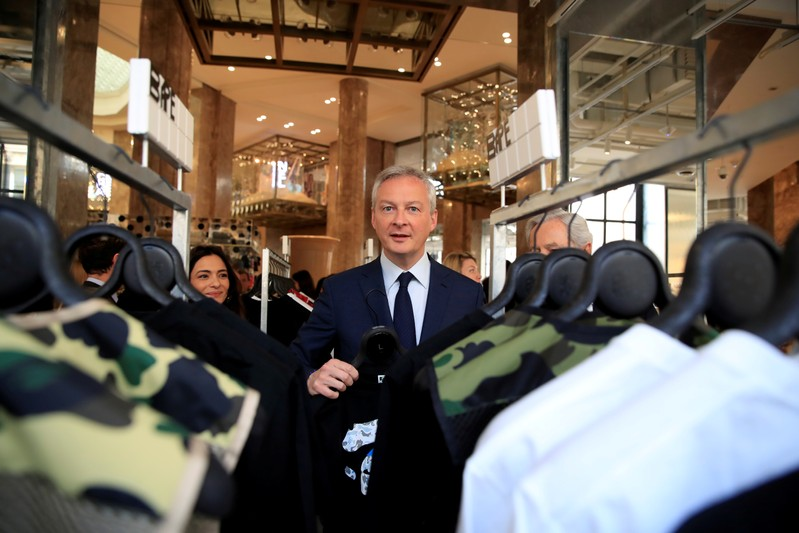 FILE PHOTO: French Finance and Economy Minister Bruno Le Maire visits the new Galeries Lafayette flaghip store on the Champs Elysees avenue in Paris