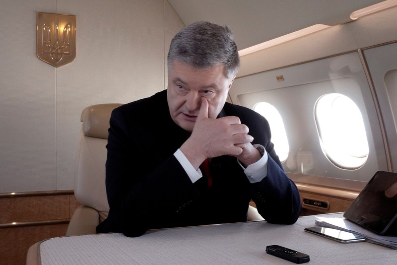 FILE PHOTO: Ukraine's President Poroshenko speaks during an interview on board his plane on the way from Berlin to Paris
