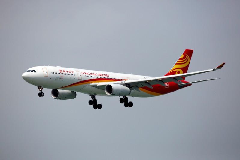 FILE PHOTO: A Hong Kong Airlines Airbus A330-343 descends before landing at Hong Kong Airport in Hong Kong
