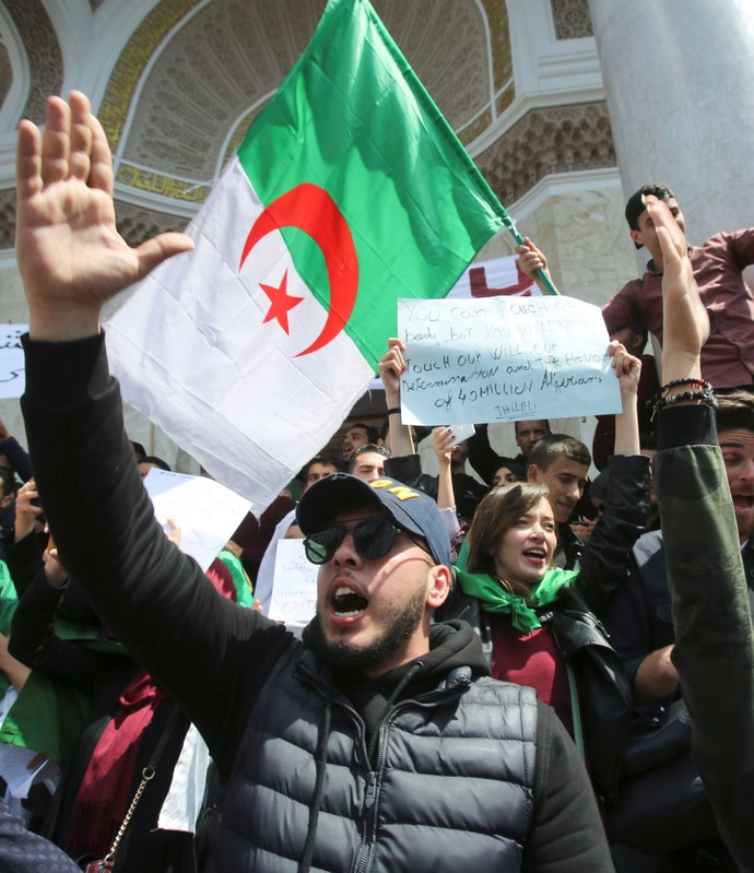 A student gestures during a protest seeking the departure of the ruling elite in Algiers