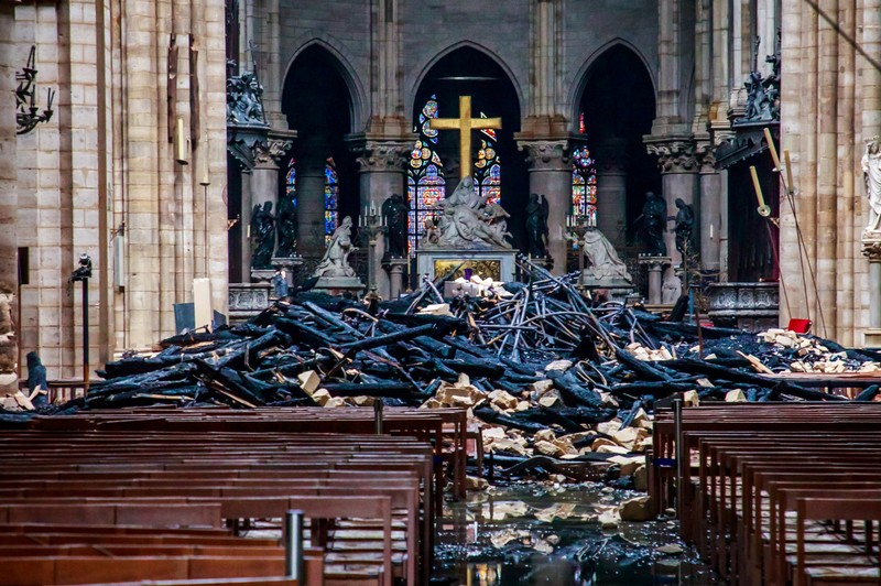 A view of the debris inside Notre-Dame de Paris in the aftermath of a fire that devastated the cathedral, during the visit of French Interior Minister Christophe Castaner, in Paris