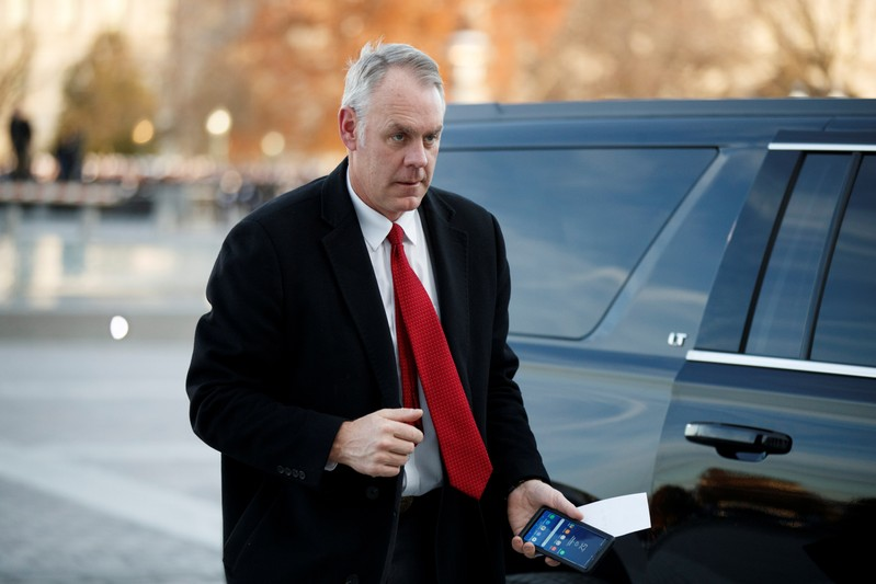 FILE PHOTO: US Secretary of the Interior Ryan Zinke arrives at the US Capitol prior to the service for former President George H. W. Bush in Washington, DC, USA