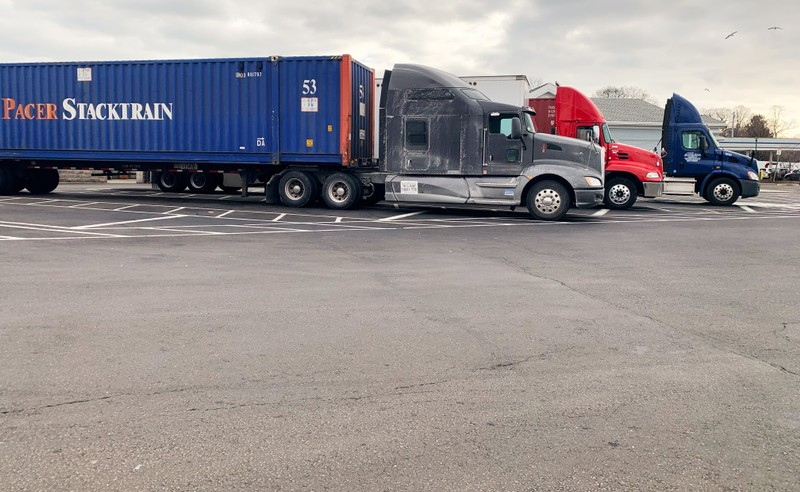 FILE PHOTO: Trucks are pictured at a truck stop along I-95 in Darien