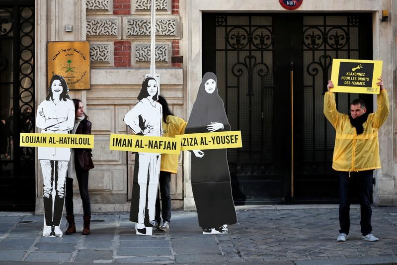 FILE PHOTO: Demonstrators from Amnesty International protest outside the Saudi Arabian Embassy on International Women's day in Paris