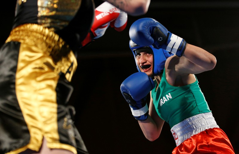Iranian boxer Sadaf Khadem in action against French boxer Anne Chauvin during an official boxing bout in Royan