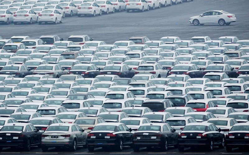 FILE PHOTO: Newly manufactured cars are seen at the automobile terminal in the port of Dalian