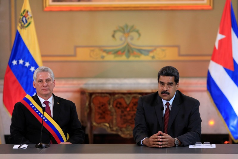 Venezuela's President Nicolas Maduro speaks next to Cuba's President Miguel Diaz-Canel during their meeting at the Miraflores Palace in Caracas