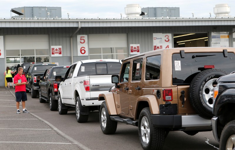 FILE PHOTO: Used vehicles are lined up in lanes before being sold during a dealer-only auction at Manheim Detroit auction house in Carleton, Michigan