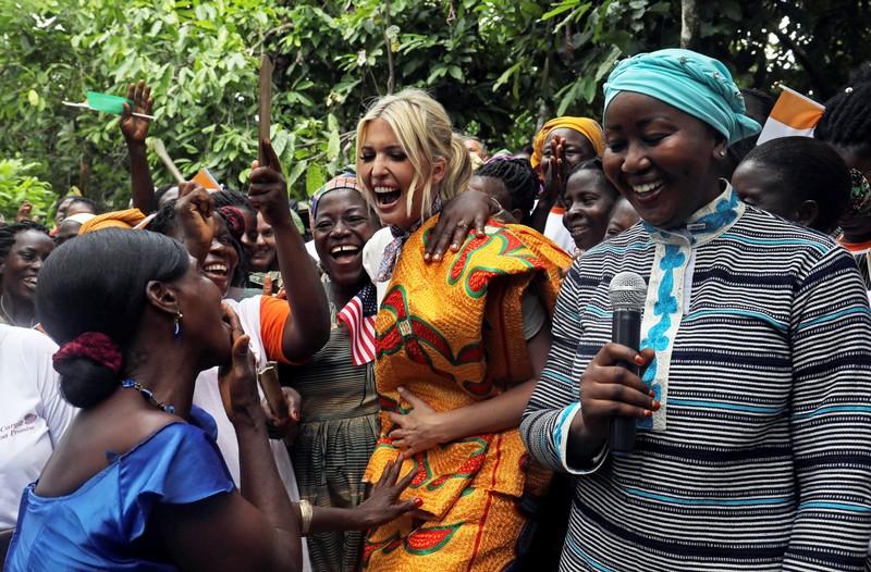 White House Advisor Ivanka Trump dances as she meets women entrepreneurs, at the demonstration cocoa farm in Adzope
