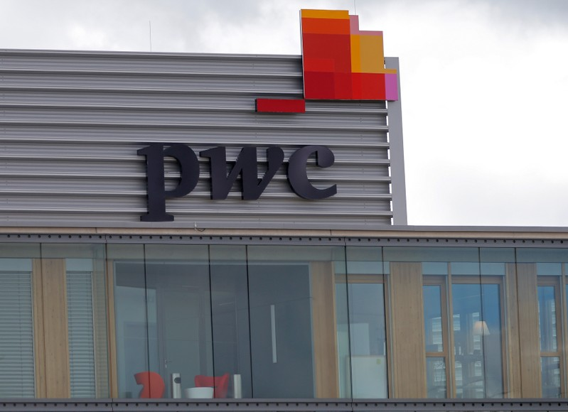 FILE PHOTO: The logo of PwC is seen on the local offices building of the company in Luxembourg