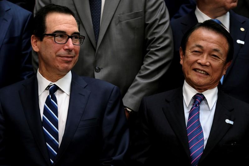FILE PHOTO: U.S. Treasury Secretary Steven Mnuchin and Japanese Finance Minister Taro Aso attend the IMF and World Bank's 2019 Annual Spring Meetings, in Washington