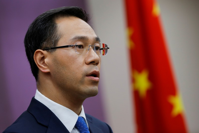 FILE PHOTO: China's Ministry of Commerce spokesperson Gao Feng attends a news conference in Beijing