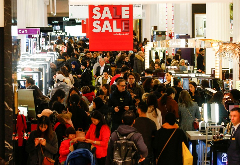 FILE PHOTO: Shoppers are seen inside the Selfridges store on Oxford Street during the Boxing Day sales in central London