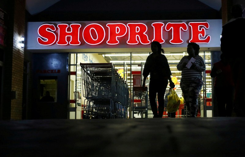FILE PHOTO: Shoppers leave the Shoprite store in Daveyton
