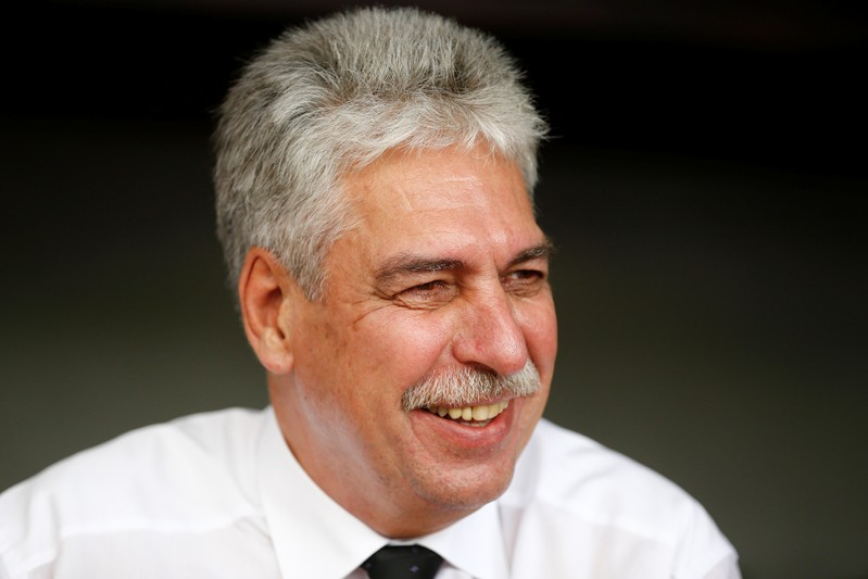 Austrian finance minister Schelling talks during a Reuters interview in Alpbach