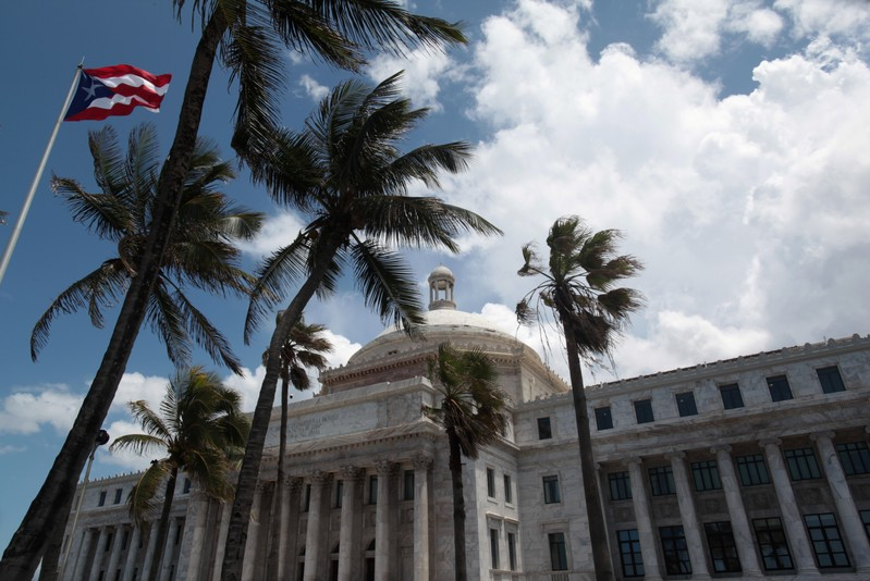 The flag of Puerto Rico flies outside the Capitol building in San Juan