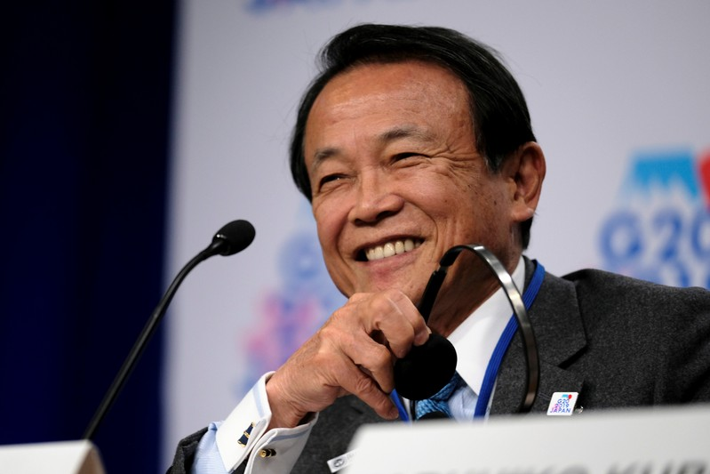 Japanese Finance Minister Taro Aso holds a news conference after the G-20 Finance Ministers and Central Bank Governors' meeting at the IMF and World Bank's 2019 Annual Spring Meetings