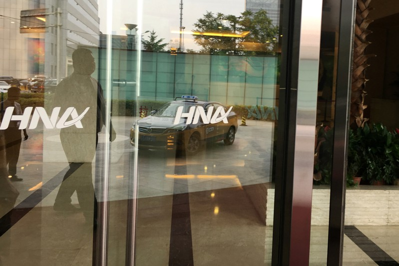 The HNA Group logo is seen on the gate of HNA Plaza building in Beijing