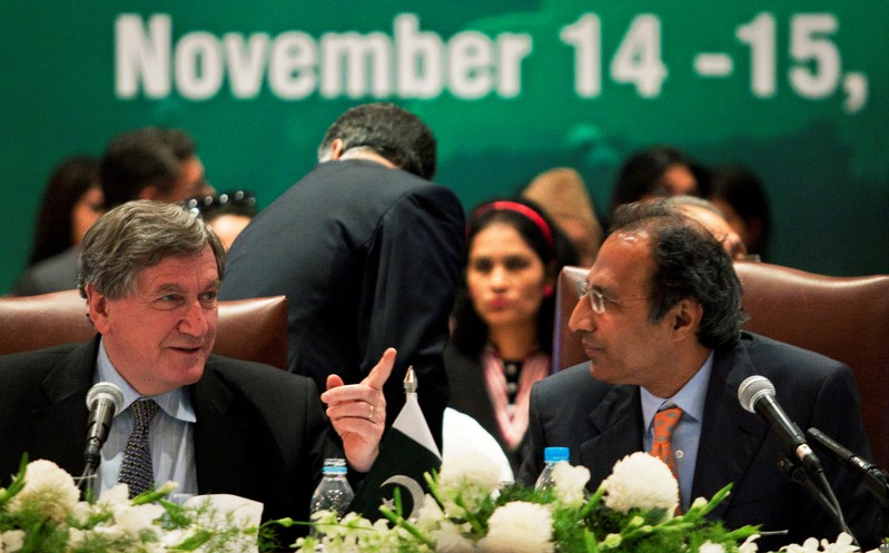 FILE PHOTO: U.S. Special Representative for Afghanistan & Pakistan Holbrooke co-chairs a session with Pakistan's Finance Minister Shaikh during the Pakistan Development Forum in Islamabad