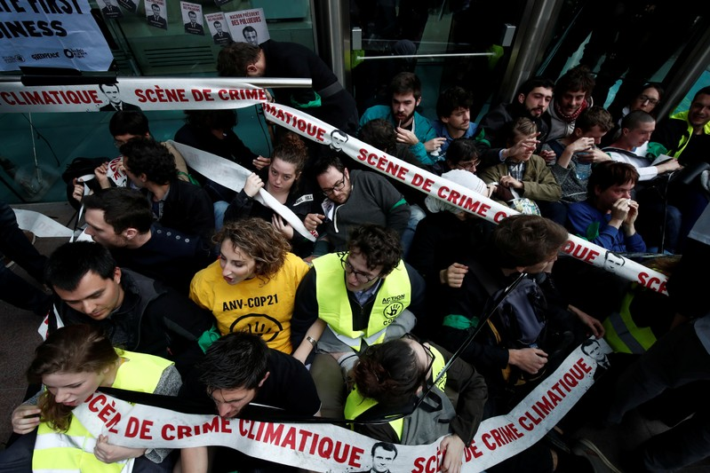 Environmental activists block the entrance of the French bank Societe Generale headquarters during a