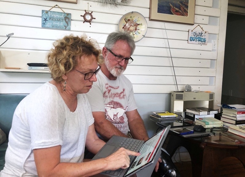 Eileen O'Brien and Michael O'Brien read the redacted report by U.S. Special Counsel Robert Mueller on Russian interference in the 2016 U.S. presidential election in Clearwater
