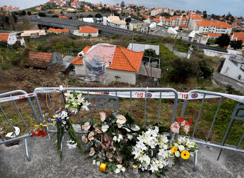 Flowers are seen at the site of a bus accident in Canico
