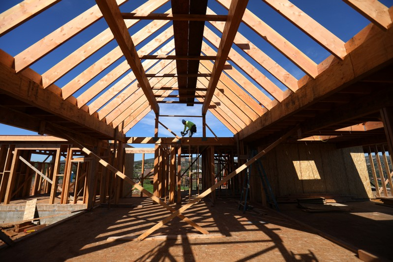 Construction worker builds a single family home in San Diego, California