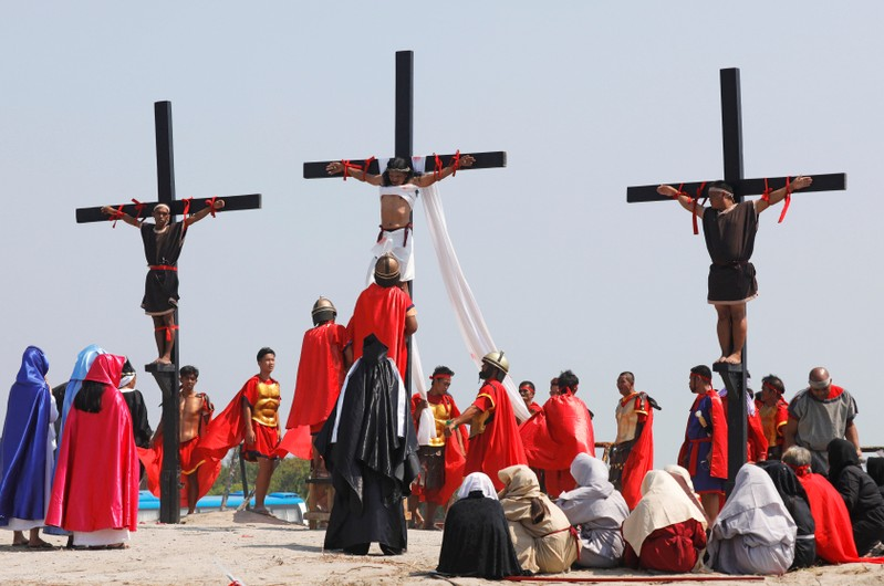 Filipino devotees are nailed on wooden crosses during a crucifixion re-enactment on Good Friday, in San Fernando City