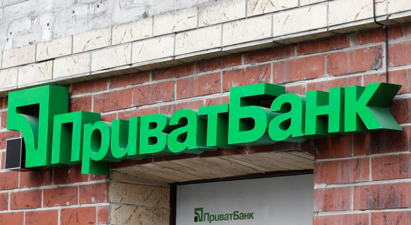 Logo of PrivatBank, the Ukraine's biggest lender, is seen on a bank's branch in Kiev